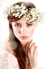 Portrait of a beautiful woman with flowers in her hair