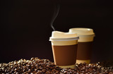 Fototapety Paper cup of coffee and coffee beans on wooden table