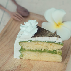 green tea cake on wooden plate, vintage cake