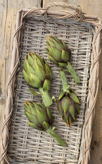 fresh artichokes in a basket, from above