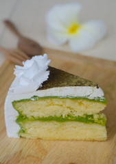 Green tea cake on wooden plate