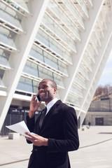 black businessman have phone conversation outdoors