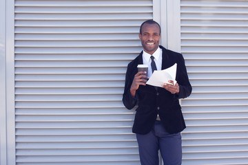 stylish black man documents handling outdoors
