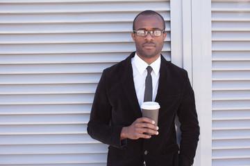 trendy black man have coffee break outdoors