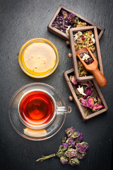 Flowers herbal tea with honey and dried herbs. top view