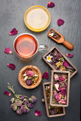 herbal tea with honey and dried herbs and flowers. top view