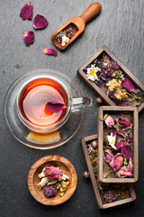 herbal tea and dried herbs and flowers. top view