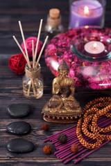 aromatherapy,  spa. Buddha statue, stone massage, incense sticks