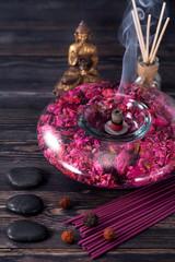 aromatherapy. spa. Buddha statue, stone massage, incense sticks