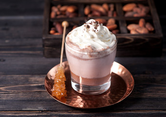 cocoa drink or hot chocolate with whipped cream and cocoa beans