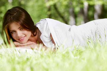 Woman wake up on grass