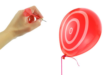 Dart about to pop a balloon isolated on white