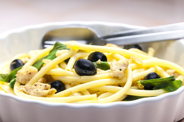 macaroni with chicken meat and black olives on sage