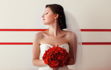 Bride posing with bouquet