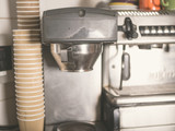 Coffee machine and paper cups