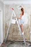 Young Woman Repair Apartment