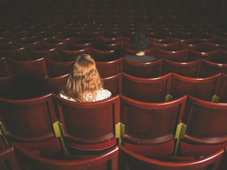 Man and woman sitting in auditorium