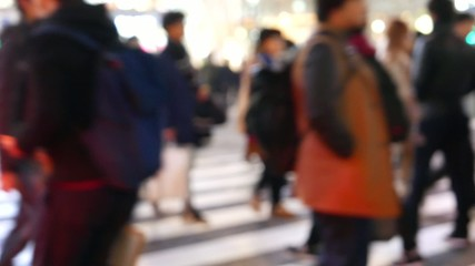 Anonymous crowd walking in Shibuya Scramble crossing, Japan