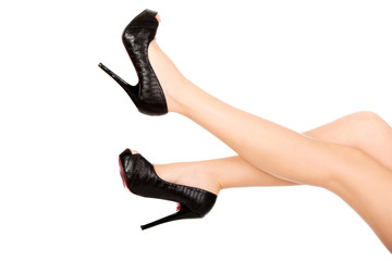 Woman legs with high heels.