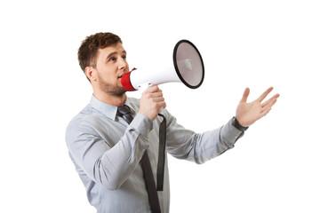 Businessman shouting through megaphone.