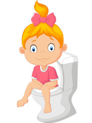 Little girl sitting on the toilet