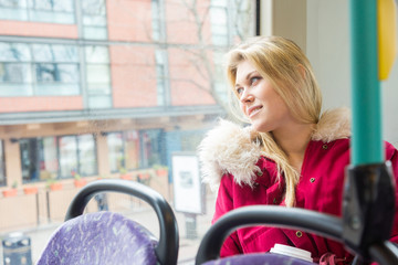 Beautiful young woman in London on double decker bus