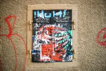 Closed window with graffiti
