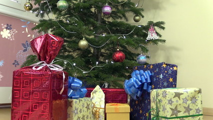 Decorated christmas fir tree and colorful gifts presents boxes