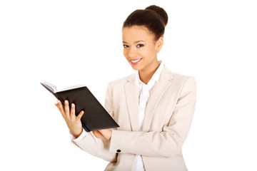 Businesswoman with a notebook.