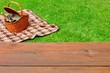Picnic  Tabletop Close-up. Picnic Basket and Blanket On The Lawn - 81438439