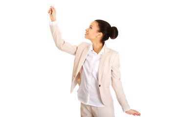 Businesswoman holding something high.