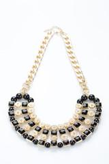metal feminine necklace. on white background.