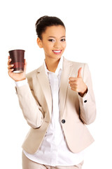 Business woman with coffee cup.