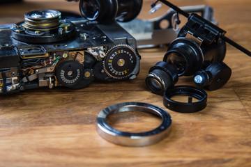 Disassembled broken film camera