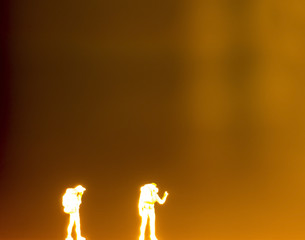 silhouette of  plastic toys standing in the night