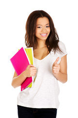 Young student woman with notes