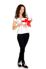 Attractive woman with gift box.