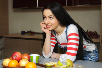 Brunette housewife in blue overalls enthusiastically listens lea