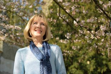 smiling mature woman enjoys springtime