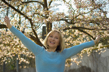attractive mature woman enjoys the sunny day