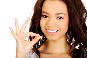Young woman showing perfect sign.
