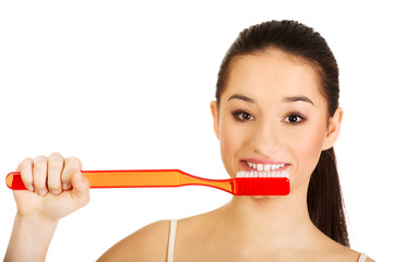 Young woman brushing her teeth.