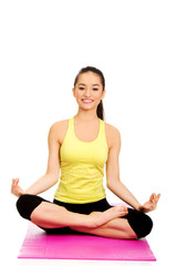 Slim female meditating in pose of lotus.