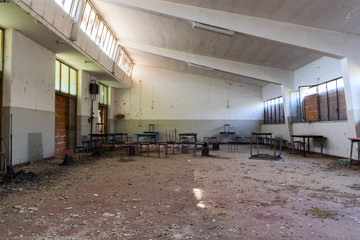 abandoned company canteen with stools and tables