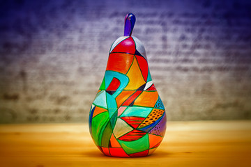 Decorative colorful fruit pear made of wood, hand-painted