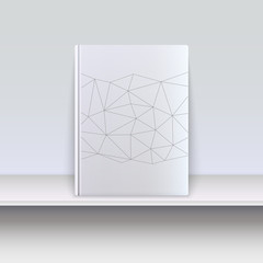 Cover book with techno pattern on a shelf.