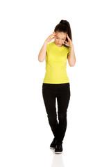 Teen woman with headache.