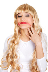 Sad woman with smeared lipstick.