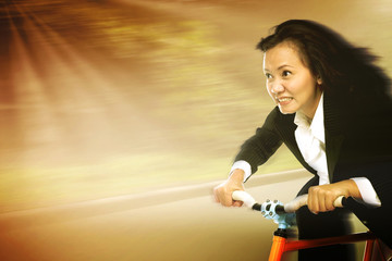 Businesswoman In A Rush Riding A Bicycle To Work