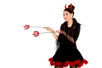 Devil woman pointing aside with trident.